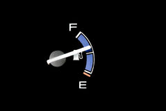 Gas gauge needle. Of a car showing a little bit above half of a tank Royalty Free Stock Photos
