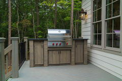 Gas grill on deck. Build-in gas grill on a residential house deck Royalty Free Stock Photo