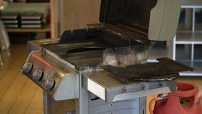 Gas grill indoors stock video footage