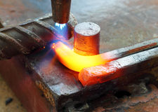 Gas heating cutting metal bending square bar Royalty Free Stock Photo
