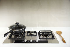 Gas Hob. A kitchen hob with a saucepan and a wooden ladle Royalty Free Stock Photography