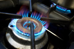 Gas hob. Close-up of kitchen gas hob burning royalty free stock photo