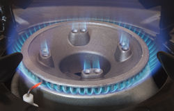 Gas hob burning blue flames Stock Images