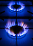 Gas Hob and flames. Close-up view of a lit gas hob Stock Photography