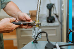 Gas hob and oven in a kitchen. The master installs a gas oven in a new building stock photography