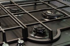 Stainless steel gas hob. The gas hob will be examined closer stock photos