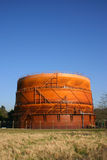 Gas Holder. Rust coloured Gas Holder photographed against blue sky at Maidenhead Stock Photos