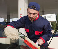 Gas Jockey Cleaning Windshield Royalty Free Stock Images