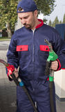 Gas Jockey Refilling Car Royalty Free Stock Photography