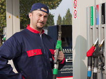 Gas Jockey Refilling Car Stock Photo