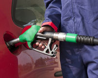 Gas Jockey Refilling Car Stock Photography