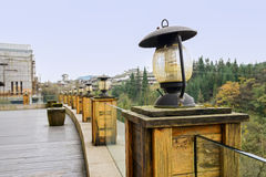Gas-lamp-like lights decorated balustrade of viewing platform fo Stock Photo