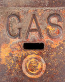 Gas Line Access Cover. This metal cover protects access to a gas utility line under a sidewalk. The colors of paint and rust, in addition to the shapes and royalty free stock photos