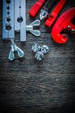 Gas line flaring clamp tube cutter brake plumper on wooden board.  Stock Photography