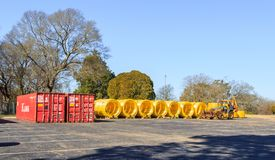 Gas Main Lines Staged in Montgomery, Alabama. Gas main lines staged in an abandoned parking lot prior to being laid. Parking lot is on a Military base in royalty free stock photography