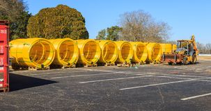 Gas Main Lines Staged in Montgomery, Alabama. Gas main lines staged in an abandoned parking lot prior to being laid. Parking lot is on a Military base in royalty free stock photos
