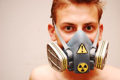 Gas mask. Young man with gas mask looking at camera Stock Photos