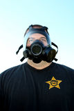 Gas Mask. Policeman wearing a gas mask looking at camera Stock Images