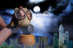 Gas mask. On background of a city with smog and pollution Royalty Free Stock Image