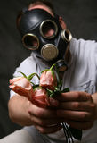 Gas mask. The man in a gas mask with flowers Royalty Free Stock Photos