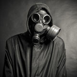 Gas mask. A man in a gas mask on a black background Royalty Free Stock Photos
