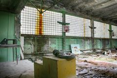 Gas mask in Abandoned Building Interior in gym school in Prypiat town in Chernobyl Zone. Chornobyl Disaster Royalty Free Stock Photos