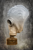 Gas mask on the ashen-gray background Stock Photo
