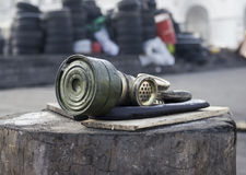 Gas mask is on a barricade stub Stock Images
