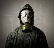 Gas mask and a city map Royalty Free Stock Photography