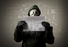 Gas mask and city map. Evacuation concept. Royalty Free Stock Photo