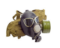 Gas mask and a cloth bag for him. Rubber gas mask with filter mounted on side of the mask and drinking tube and a cloth bag for him on a light background Stock Image