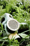 Gas Mask on grass. Gas mask on blurry green background royalty free stock images