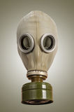 Gas mask on a gray background Stock Photos
