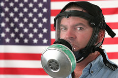 Gas Mask Horizontal. A man wearing a gas mask with an American flag in the background Royalty Free Stock Photography