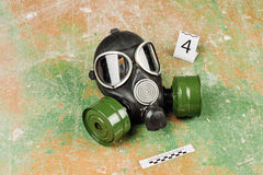Gas mask lying on the floor. crime scene Royalty Free Stock Image