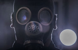 Gas mask. A man in a gas mask with the abstract background royalty free stock photography