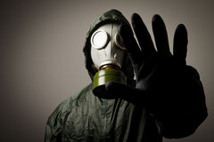 Gas mask. Man wearing a gas mask on his face Stock Image