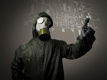 Gas mask and map. Evacuation. Man wearing a gas mask on his face. Gas mask and city map. Evacuation concept Royalty Free Stock Photography