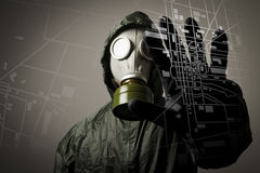 Gas mask and map. Evacuation. Man wearing a gas mask on his face. Gas mask and city map. Evacuation concept Stock Photography