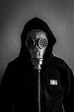Man with gas mask. A black and white portrait of a man with a gas mask and a hood over his head Royalty Free Stock Image
