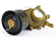 Gas mask from real war. Used vintage green and black gas mask can illustrate danger, war, catastrophe, or other concept. Gas mask on isolated white studio Royalty Free Stock Images