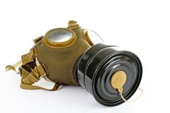 Gas mask from real war. Used vintage green and black gas mask can illustrate danger, war, catastrophe, or other concept. Gas mask from ww2 real war. Used vintage Royalty Free Stock Images