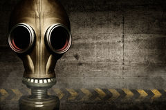 Gas mask shrouded in smoke Stock Photo