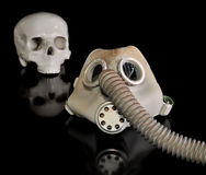 Gas mask and skull. On a Black background Stock Photos