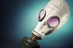 Gas mask with smoke on a blue bakground Stock Photos