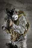 Gas Mask Soldier aiming rifle Royalty Free Stock Photos