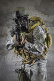 Gas Mask Soldier aiming rifle Stock Image