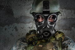 Gas Mask Soldier. Looking at camera royalty free stock image