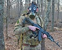 Gas Mask Soldier. A special forces soldier wears a gas mask in a fallout situation Royalty Free Stock Photos