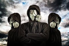 Gas mask soldiers. Over heavy storm clouds in background Stock Image